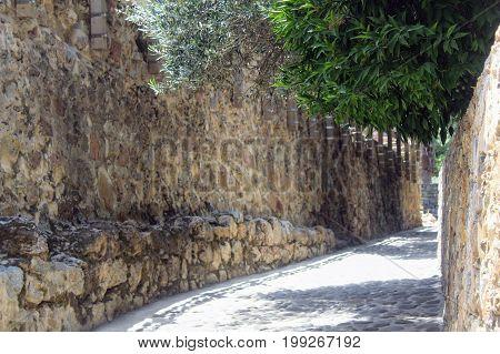 Cobbled path along the fortress wall (Alanya, Turkey).