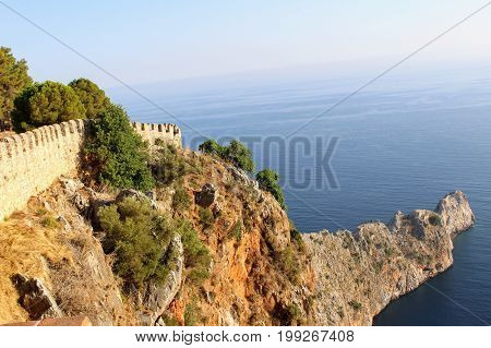 View of the narrow promontory from the observation deck of Alanya Castle (Alanya, Turkey).