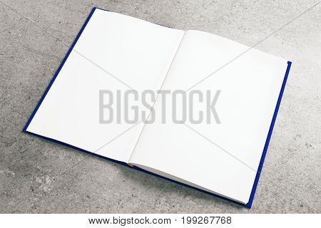 Empty white notepad on concrete surface. Advertisement supplies education text copy space concept. Mock up 3D Rendering