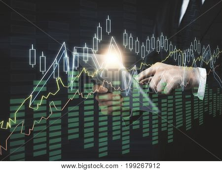 Businessman using tablet with abstract forex chart hologram. Accounting trade and research concept. Double exposure
