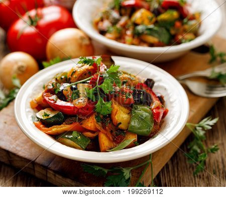 Ratatouille, Vegetable stew made of zucchini, eggplants, peppers, onions, garlic and tomatoes with aromatic herbs. Traditional french food