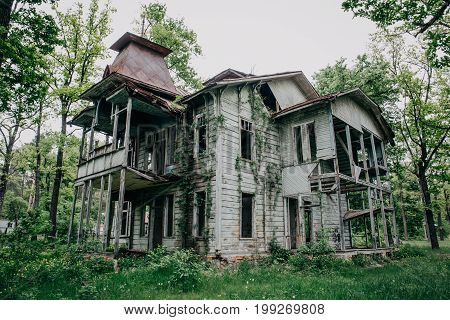 Two story abandoned wooden antique vintage mansion