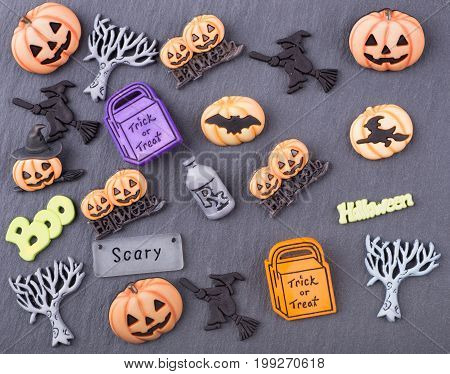 Halloween decoration objects on a gray textured background