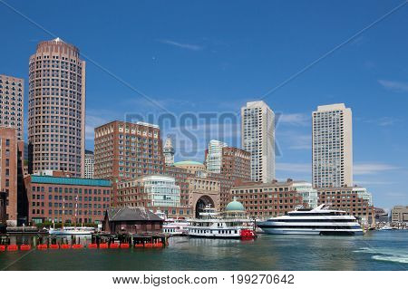 Boston Massachsetts USA - July 2 2016: Boston skyline from Seaport boulevard bridge.
