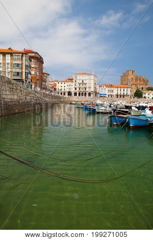Castro Urdiales Spain - July 9 2017: Harbor in Castro Urdiales.It is a seaport situated on the bay of Biscay and a modern town although its castle and the Gothic style parish church of Santa María de la Asunción date from the Middle Ages.