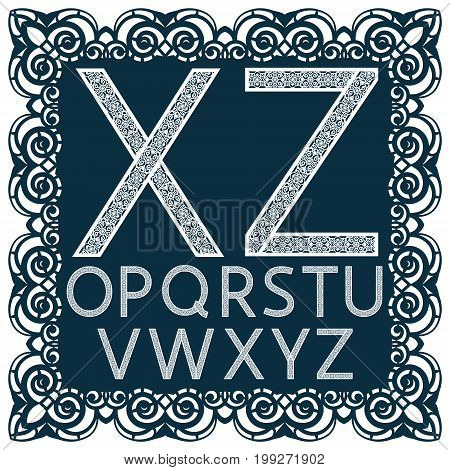 Templates for cutting out letters. Full English alphabet. May be used for laser cutting. Fancy lace letters. Font isolated blue background. A set of symbols in a lacy frame. Part 2. Vector.