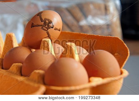 11/08/2017, London kitchen, a tray of eggs with one marked with a skull and crossbones