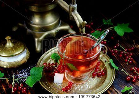tea with sugar red currant with antique kitchenware