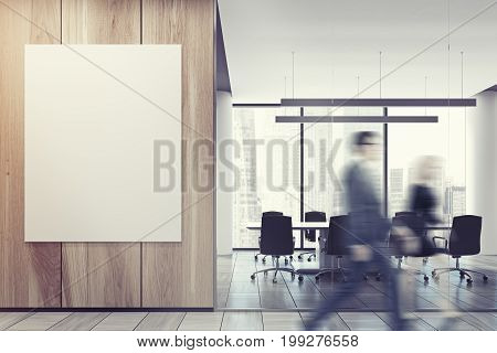 Business people in an office lobby with a glass and wooden walls a vertical poster and an open office environment with white computer tables and loft windows. 3d rendering mock up