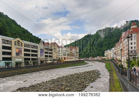 Multilevel Parking, Shopping Centers And Hotel Buildings Of The Ski Resort Rosa Khutor Along The Riv