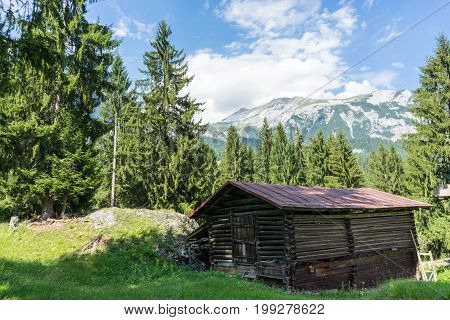 barn in the mountains wit panoramic view in summer