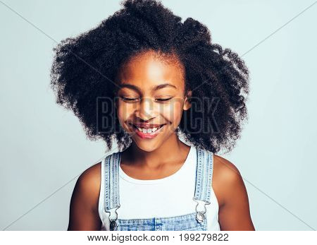 Smiling Little African Girl Standing With Her Eyes Closed