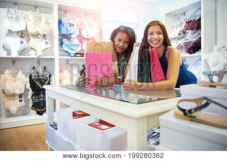 Two Happy Female Friends Shopping For Clothes