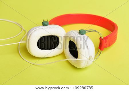 Modern And Stylish Earphones Isolated On Yellow Background