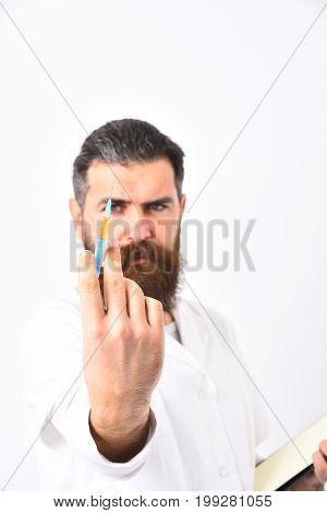 Bearded Doctor With Stylish Haircut Holding Syringe.