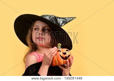 Kid In Black Witch Hat, Dress And Tricky Face
