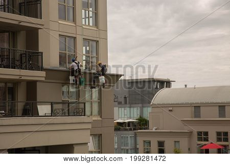 Safety measures workinh high altitute highrise building exterior cleaning