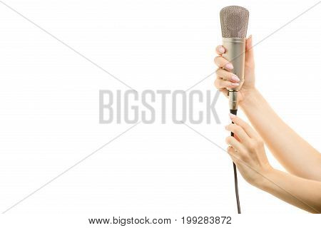 Microphone in a female hands on a white background isolation