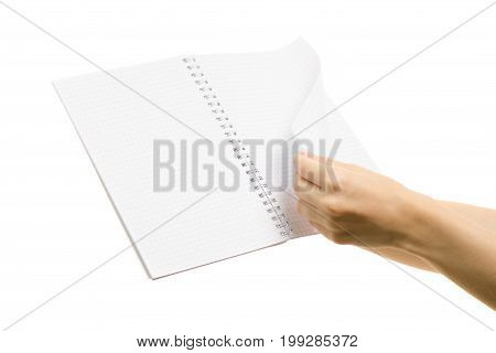 White open notebook page flip in female hand on white background isolation