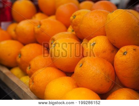 lots of fresh oranges on the counter