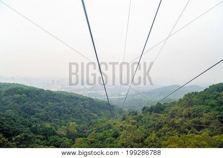 Cable car ropes on city background in Bayun mountain Guangzhou China