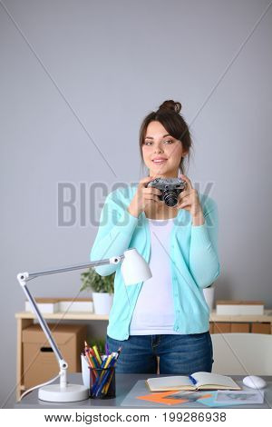 Woman is a proffessional photographer with camera .