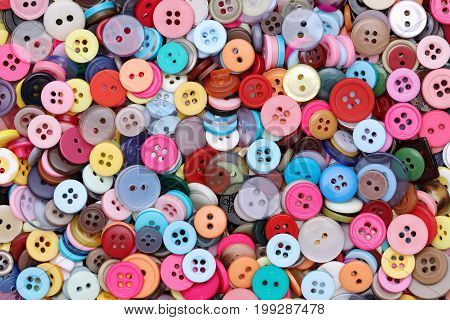 colorful background made from sewing buttons, pile of buttons