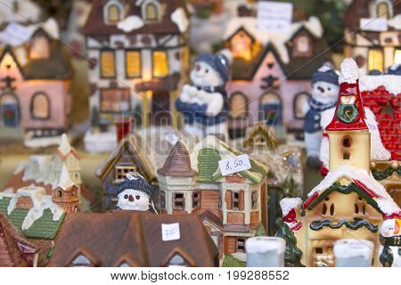 Decorative miniature house on christmas market with price tags in germany