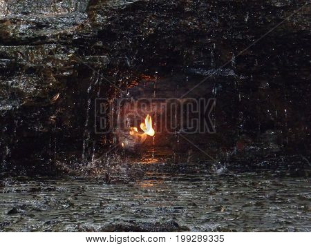 Eternal Flame beneath waterfall in Western NY