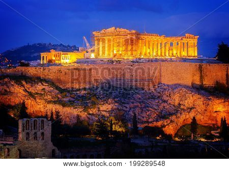 Famous skyline of Athens with Acropolis hill and Pathenon illuminated at night, Athens Greece, retro toned