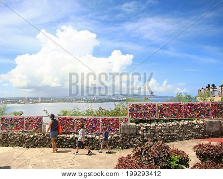 GUAM, USA--Tourists visit the Two Lover's Point or Puntan Dos Amantes in December 2016, a top attraction on Guam
