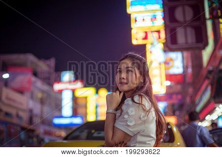 Portrait of asian woman outdoor in night. Christmas and New Year concept