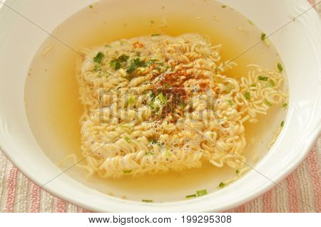 soft boiled instant noodles dressing seasoning on bowl