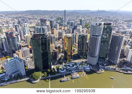 BRISBANE, AUSTRALIA - AUGUST 1 2017:  Aerial view of Brisbane Riverside, overlooking Eagle Street Pier and ferry terminals with docked paddle wheelers.