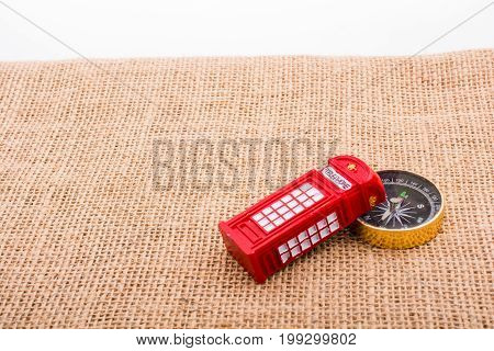 Compass And Red Color Phone Booth