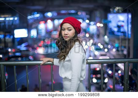 Portrait of lonely asian woman outdoor in night