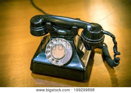 Vintage retro telephone on wood old table