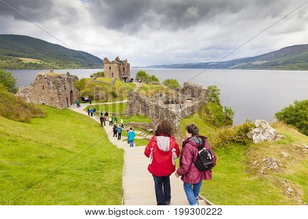 July 2014 :urquhart castle lockness scotland england in a cloudy day sits beside Loch Ness in the Highlands of Scotland