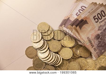 mexican pesos banknotes and coins with copy space