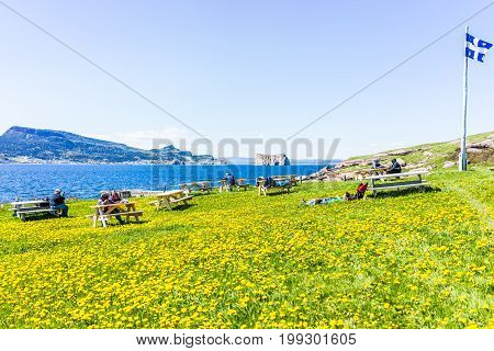 Perce Canada - June 6 2017: Bonaventure Island Park entrance in Gaspe Peninsula Quebec Gaspesie region with people sitting at picnic tables