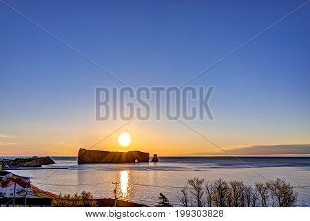 Famous Rocher Perce Rock In Gaspe Peninsula, Quebec, Canada, Gaspesie Region At Purple Sunrise And S