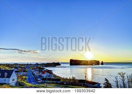 Famous Rocher Perce Rock In Gaspe Peninsula, Quebec, Canada, Gaspesie Region At Blue Sunrise And Sun