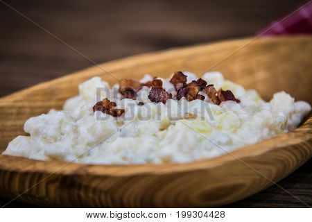 Slovak traditional food - potato gnocchi dumplings with sheep cheese and bacon.