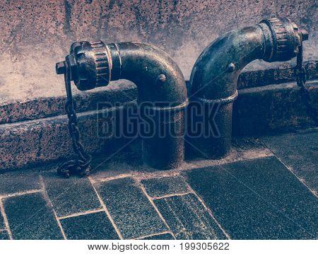 steel water pipe on roadside,retro styled.