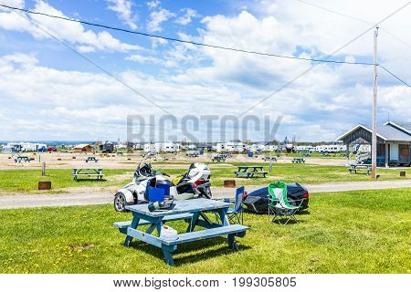 Bonaventure Canada - June 7 2017: Camping Plage Beaubassin mobile trailer park in summer with picnic tables