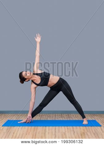 Healthy Woman Exercising Yoga At Sport Gym, Girl Doing Sport Indoor.photo Design For Fitness Sporty