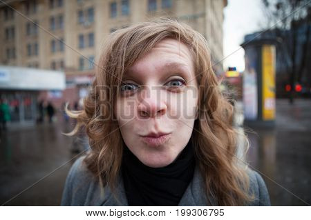 Humorous portrait of a young blond woman.