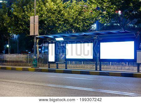 bus stop with blank billboard at night,shanghai,china.