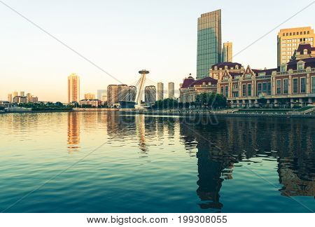 twilight view of waterfront downtown skyline,Tianjin,China.