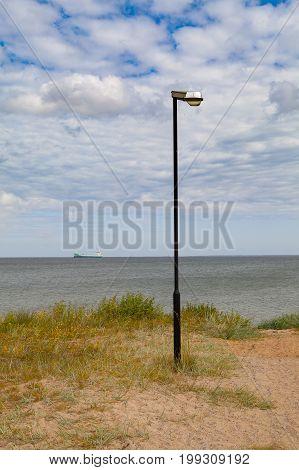 Baltic sea's coact with promenade lantern and ship, Viimsi, Estonia